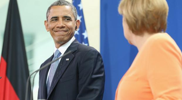 BERLIN, GERMANY - JUNE 19: U.S. President Barack Obama (L) and German Chancellor Angela Merkel arrive to speak to the media following bilateral talks at the Chancellery on June 19, 2013 in Berlin, Germany. Obama is visiting Berlin for the first time during his presidency and his speech at the Brandenburg Gate is to be the highlight. Obama will be speaking close to the 50th anniversary of the historic speech by then U.S. President John F. Kennedy in Berlin in 1963, during which he proclaimed the famous sentence: