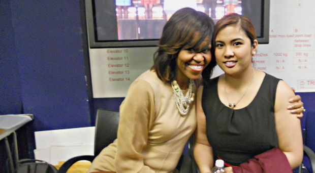 Michelle Obama pictured backstage at the Waterfront Hall with Queen's University student and member of Belfast City Council Youth Forum, Denise Fuenzalida