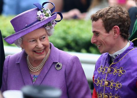 Queen Elizabeth II talks with Jockey Ryan Moore