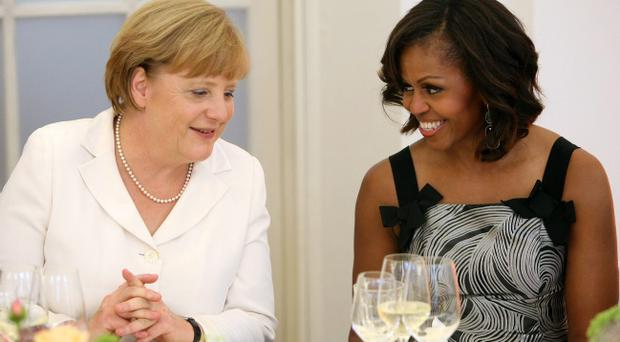 German Chancellor Angela Merkel speaks to U.S. First Lady Michelle Obama at a dinner at the Orangerie at Schloss Charlottenburg palace on June 19, 2013 in Berlin, Germany. (Photo by Adam Berry/Getty Images)