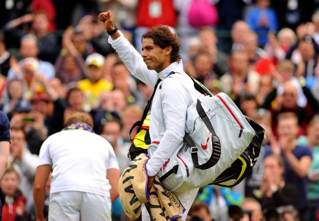 Spain's Rafael Nadal waves to the crowd after losing to Belgium's Steve Darcis during day one of the Wimbledon Championships