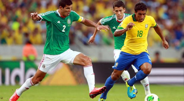 FORTALEZA, BRAZIL - JUNE 19: Francisco Javier Rodriguez of Mexico challenges Paulinho of Brazil during the FIFA Confederations Cup Brazil 2013 Group A match between Brazil and Mexico at Castelao on June 19, 2013 in Fortaleza, Brazil. (Photo by Scott Heavey/Getty Images)