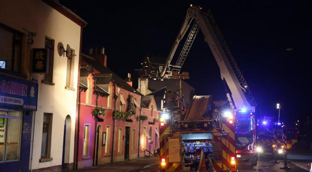 The scene in Carrickfergus after a fire broke out at the Joymount Arms causing extensive damage too the downstairs area of the bar. Pic Kevin McAuley