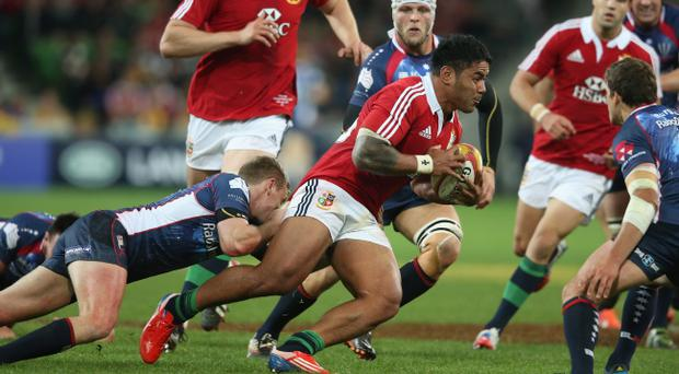MELBOURNE, AUSTRALIA - JUNE 25: Manu Tuilagi of the Lions races away from Bryce Hegarty during the International Tour Match between the Melbourne Rebels and the British & Irish Lions at AAMI Park on June 25, 2013 in Melbourne, Australia. (Photo by David Rogers/Getty Images)