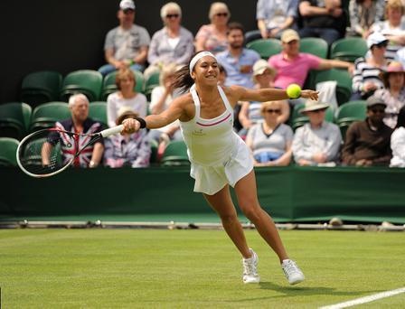 Great Britain's Heather Watson in action against USA's Madison Keys during day Two of the Wimbledon Championships at The All England Lawn Tennis and Croquet Club