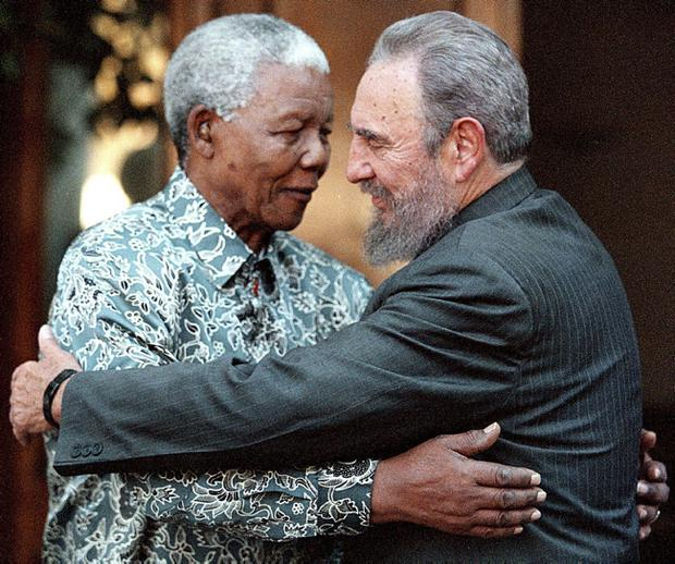 File photo of Cuba's President Fidel Castro and former South Africa's President Mandela in Johannesburg during a visit to Mandela's home in Houghton, Johannesburg in this September 2, 2001 file photo.