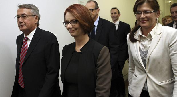 CANBERRA, AUSTRALIA - JUNE 26: Australian Prime MInister Julia Gillard (C) and supporters enter the caucus room for the leadership ballot at Parliament House on June 26, 2013 in Canberra, Australia. (Photo by Stefan Postles/Getty Images)