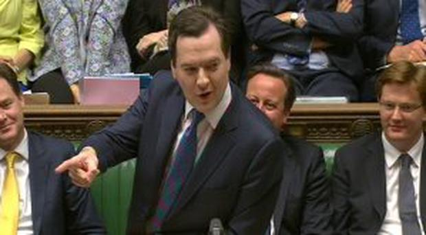 Chancellor George Osborne speaking in the House of Commons in London about his final spending plans before the country goes to the polls in 2015.