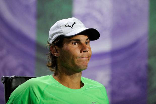 LONDON, ENGLAND - JUNE 24: Rafael Nadal of Spain reacts as he speaks to members of the media during a press conference following his defeat to Steve Darcis of Belgium in their Gentlemen's Singles first round match on day one of the Wimbledon Lawn Tennis Championships at the All England Lawn Tennis and Croquet Club on June 24, 2013 in London, England. (Photo by Thomas Lovelock/AELTC - Pool/Getty Images)
