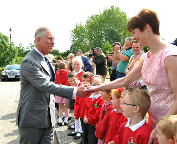 On the second day of engagements, TRH The Prince of Wales and The Duchess of Cornwall visited the historic village of Caledon. They were accompanied by Lord Caledon and his wife, Lady Caledon. Prince Charles meets staff and pupils from Churchill Primary School. Picture: Conor Greenan/Pacemaker