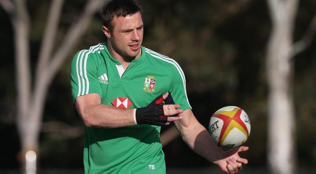 MELBOURNE, AUSTRALIA - JUNE 27: Tommy Bowe, who has been selected to play for the Lions in the second test match against the Wallabies, passes the ball during the British and Irish Lions training session held at Scotch College on June 27, 2013 in Melbourne, Australia. (Photo by David Rogers/Getty Images)