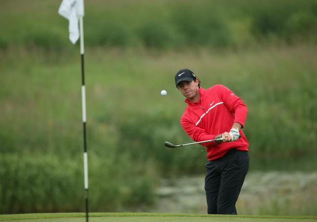 MAYNOOTH, IRELAND - JUNE 27: Rory McIlroy of Northern Ireland plays a chip shot on the 18th hole during the first round of the Irish Open at Carton House Golf Club on June 27, 2013 in Maynooth, Ireland. (Photo by Andrew Redington/Getty Images)