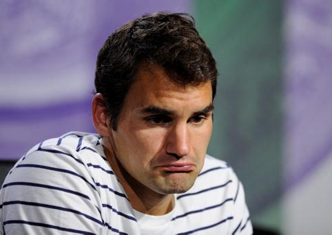 Switzerland's Roger Federer speaks during a press conference following his defeat to Ukraine's Sergiy Stakhovsky during day three of the Wimbledon Championships