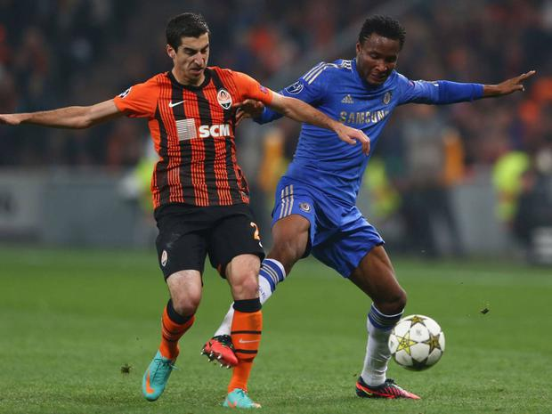 Henrikh Mkhitaryan (left) takes on Chelsea's John Obi Mikel in 2012