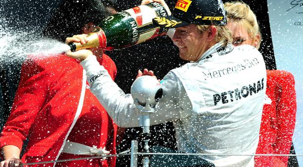 Mercedes Nico Rosberg celebrates winning the 2013 Santander British Grand Prix at Silverstone Circuit, Towcester