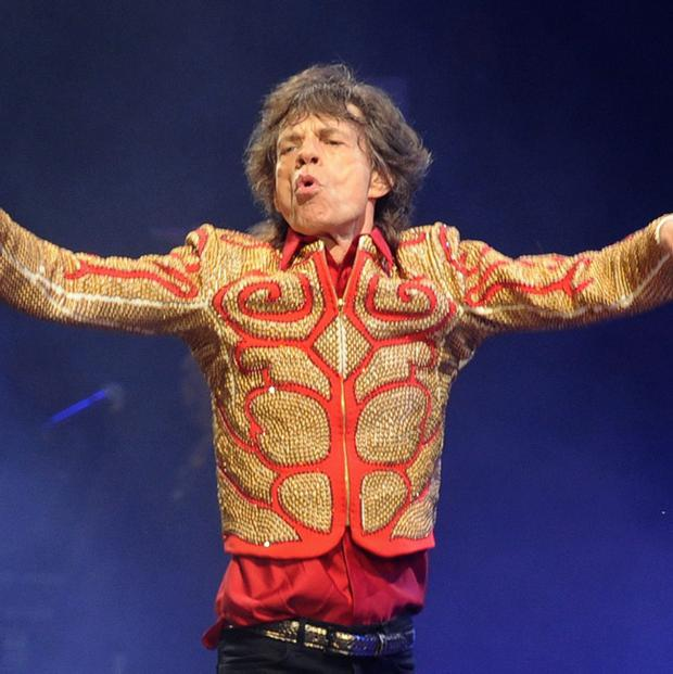 Mick Jagger from the Rolling Stones performs on the Pyramid Stage during the Glastonbury 2013 Festival of Contemporary Performing Arts at Pilton Farm, Somerset. Anthony Devlin/PA Wire