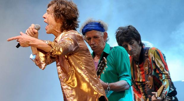 (left to right) Mick Jagger, Keith Richards and Ronnie Wood from the Rolling Stones perform on the Pyramid Stage during the Glastonbury 2013 Festival of Contemporary Performing Arts at Pilton Farm, Somerset. PRESS ASSOCIATION Photo. Picture date: Saturday June 29, 2013. See PA story SHOWBIZ Glastonbury. Photo credit should read: Anthony Devlin/PA Wire