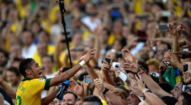 RIO DE JANEIRO, BRAZIL - JUNE 30: Neymar of Brazi celebrates with fans at the end of the FIFA Confederations Cup Brazil 2013 Final match between Brazil and Spain at Maracana on June 30, 2013 in Rio de Janeiro, Brazil. (Photo by Laurence Griffiths/Getty Images)