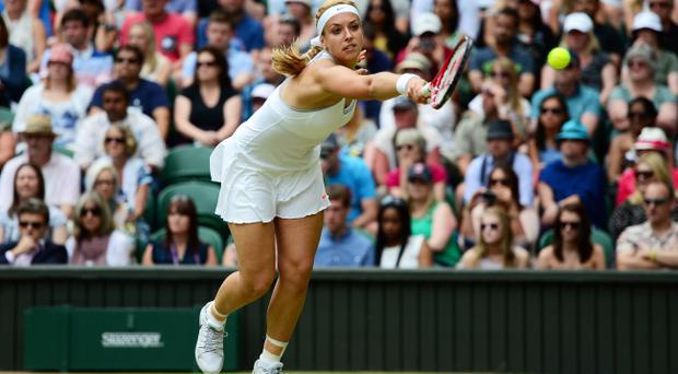 LONDON, ENGLAND - JULY 01: Sabine Lisicki of Germany stretches for a backhand during her Ladies' Singles fourth round match against Serena Williams of United States of America on day seven of the Wimbledon Lawn Tennis Championships at the All England Lawn Tennis and Croquet Club on July 1, 2013 in London, England. (Photo by Mike Hewitt/Getty Images)