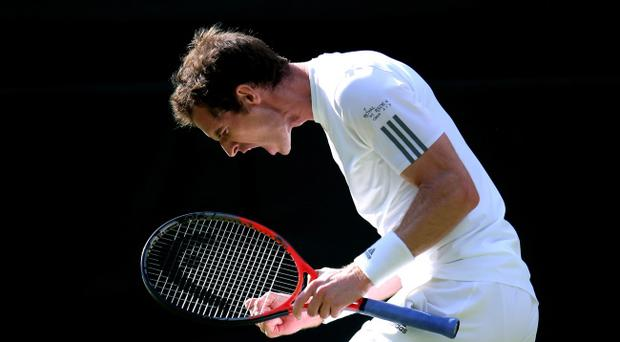 LONDON, ENGLAND - JULY 01: Andy Murray of Great Britain celebrates match point during the Gentlemen's Singles fourth round match against Mikhail Youzhny of Russia on day seven of the Wimbledon Lawn Tennis Championships at the All England Lawn Tennis and Croquet Club on July 1, 2013 in London, England. (Photo by Julian Finney/Getty Images)