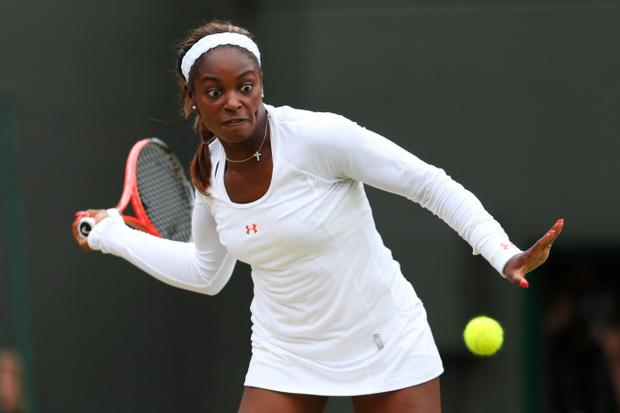LONDON, ENGLAND - JULY 02: Sloane Stephens of United States of America plays a forehand during the Ladies' Singles quarter-final match against Marion Bartoli of France on day eight of the Wimbledon Lawn Tennis Championships at the All England Lawn Tennis and Croquet Club at Wimbledon on July 2, 2013 in London, England. (Photo by Julian Finney/Getty Images)