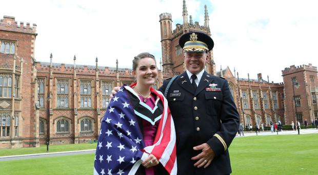 US student Lauren Halstead from Virginia graduates in Archeology from Queen's University, Belfast, Northern Ireland, 3rd July 2013. She celebrates alongside her step-father Ray Michael Compson who is a major in the US Army. Photo: Paul McErlane