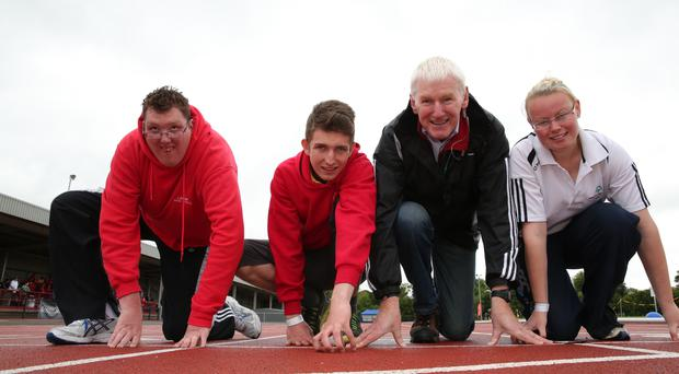 John McKernan, chairman of Special Olympics Ulster is under starters orders with athletes Stephen Daly (Banbridge), Roy Hughes (Larne) and Nicolle Smith (North Down) as they get set for the Special Olympics Ireland Games next year