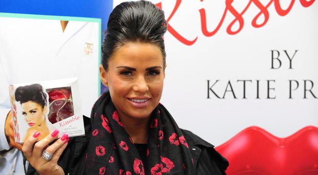 Katie Price visits Gordons Chemists, Cornmarket, Belfast to promote her latest fragrance, Kissable. Picture By: Arthur Allison/Pacemaker Press