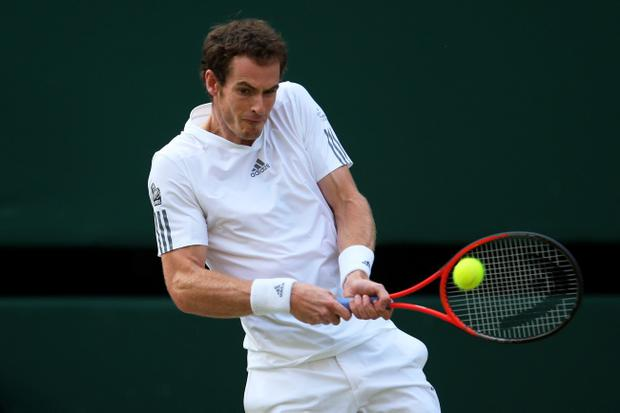 Andy Murray of Great Britain plays a backhand during the Gentlemen's Singles semi-final match against Jerzy Janowicz of Poland on day eleven of the Wimbledon Lawn Tennis Championships at the All England Lawn Tennis and Croquet Club on July 5, 2013 in London, England. (Photo by Julian Finney/Getty Images)
