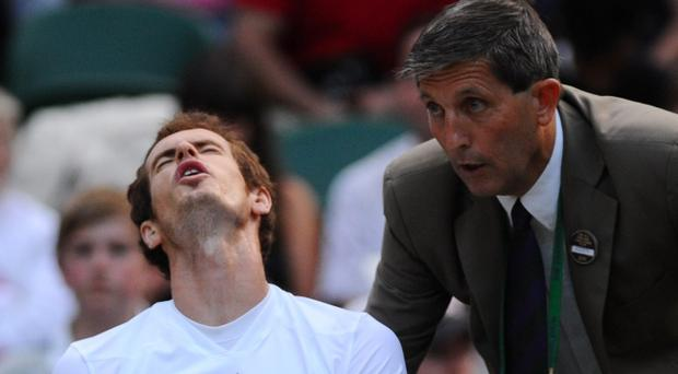 Scot Andy Murray reacts as Championships' referee Andrew Jarrett explains a decision