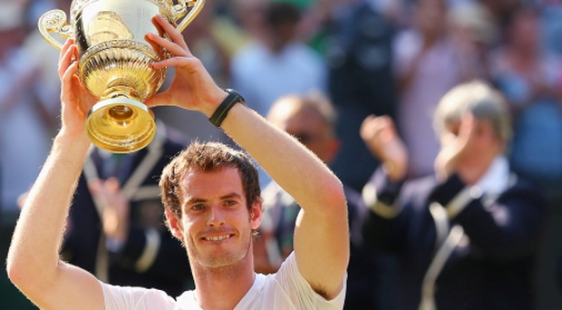 Andy Murray poses with the Gentlemen's Singles Trophy following his victory in the Wimbledon final against Novak Djokovic