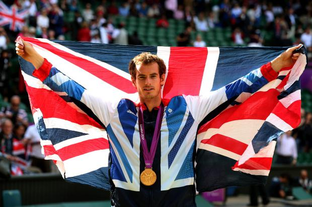 Andy Murray celebrates during the medal ceremony for the Men's Singles Tennis match on Day 9 of the London 2012 Olympic Games at the All England Lawn Tennis and Croquet Club on August 5, 2012 in London, England. Murray defeated Federer in the gold medal match in straight sets 2-6, 1-6, 4-6. (Photo by Clive Brunskill/Getty Images)