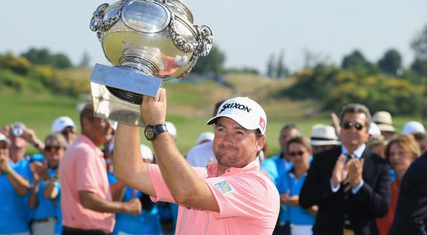 PARIS, FRANCE - JULY 07: Graeme McDowell of Northern Ireland poses with the trophy after victory in the final round of the Alstom Open de France at Le Golf National on July 7, 2013 in Paris, France. (Photo by Richard Heathcote/Getty Images)