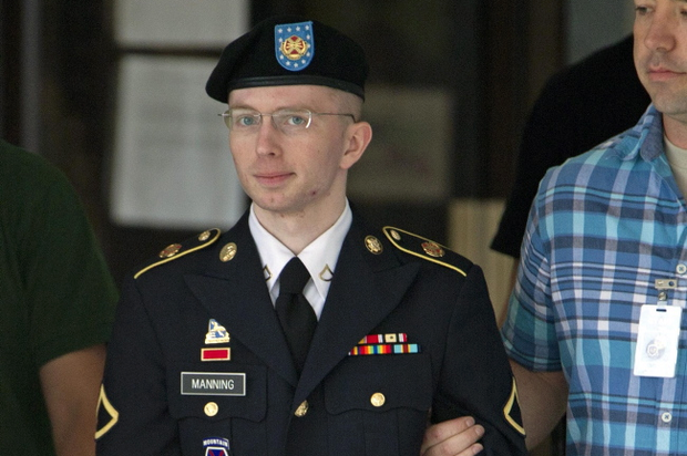 Army Pfc. Bradley Manning is escorted out of a courthouse in Fort Meade, Md., Tuesday, July 2, 2013, during the fifth week of his court martial. U.S. prosecutors rested their case against Bradley Manning on Tuesday. Manning is charged with 21 offenses, including aiding the enemy, which carries a possible life sentence. (AP Photo/Jose Luis Magana)