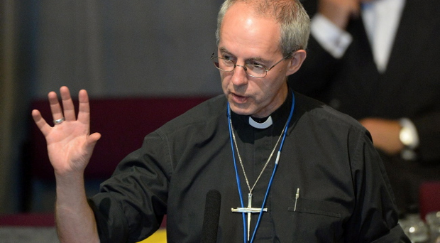 The Archbishop of Canterbury the Most Reverend Justin Welby makes his first Presidential Address to the Church of England General Synod opening session at York University, York. The Archbishop of Canterbury is to give a key speech to members of the Church of England's national assembly as attempts to restart talks over introducing women bishops get under way. Photo John Giles/PA Wire