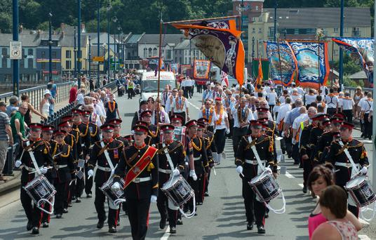The main Twelfth of July Parade crosses the Craigavon Bridge in Londonderry on friday. Picture Martin Mckeown. Inpresspics.com. 12.0713