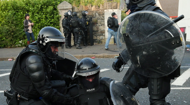 A police officer is injured during violence with loyalists in north Belfast during the Twelfth of July