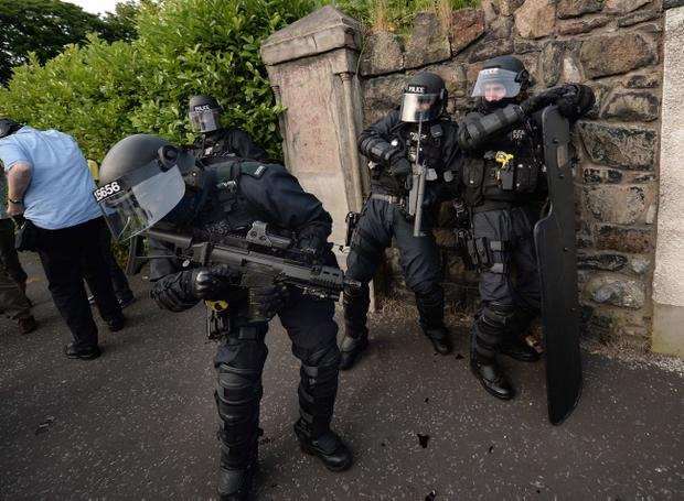 A riot squad PSNI officer is struck by a bottle as serious trouble broke out last night as police enforced the Parades Commission's ruling that Orange bandsmen could not return past the nationalist Ardoyne area after the annual 12th of July parade