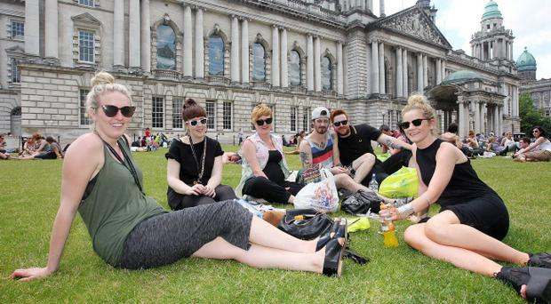 Young city workers enjoy lunch at Belfast City Hall. Left to right Sandra, Claire, Alison, Rich, Benjamin and Kelly from Urban Outfitters.