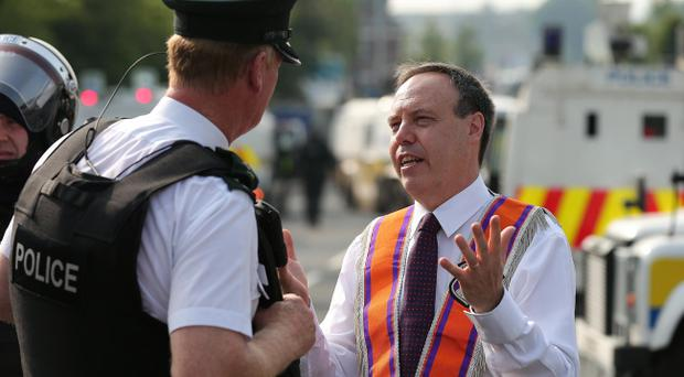Nigel Dodds with police on the 12th of July, before he was injured. Picture by Kelvin Boyes / Press Eye.