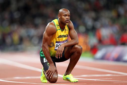 Jamaican Sprinter Asafa Powell is reportedly one of five Jamaican athletes who has tested positive for a banned substance. Powell looks to the scoreboard after competing the Men's 100m Final on Day 9 of the London 2012 Olympic Games at the Olympic Stadium on August 5, 2012 in London, England. (Photo by Michael Steele/Getty Images)