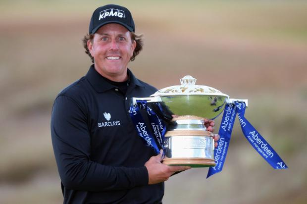 INVERNESS, SCOTLAND - JULY 14: Phil Mickelson of the United States poses with the trophy after his victory on the 1st hole of a sudden-death playoff during the final round of the Aberdeen Asset Management Scottish Open at Castle Stuart Golf Links on July 14, 2013 in Inverness, Scotland. (Photo by Andrew Redington/Getty Images)
