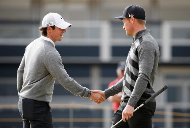 GULLANE, SCOTLAND - JULY 15: Rory McIlroy of Northern Ireland shakes hands with Oliver Fisher of England ahead of the 142nd Open Championship at Muirfield on July 15, 2013 in Gullane, Scotland. (Photo by Rob Carr/Getty Images)