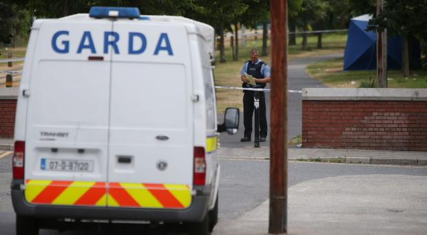 Police at the scene in Grand Canal View, near Davitt Road, Kilmainham in Dublin, where a 27-year-old man was shot dead shortly before 10.30am, as detectives believe morning commuters may have seen the killers behind the country's latest gangland-style shooting