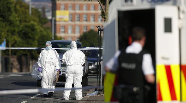 PSNI officers at the Crumlin Road in north Belfast after a pipe bomb is thrown at police. The device exploded close to police but there were no reported injuries. Motorists have been advised to avoid the area. Picture by Kelvin Boyes / Press Eye.
