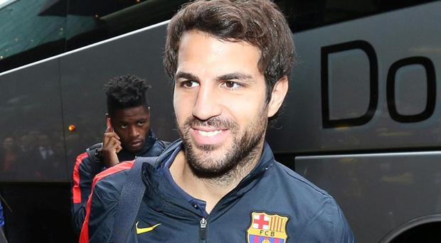 Cesc Fabregas is thought to favour staying with Barcelona despite interest from Manchester United