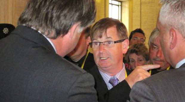 Prominent loyalist flag protester Willie Frazer with Basil McCrea at the Stormont Assembly in Belfast, shortly before he was arrested by the PSNI for breach of bail conditions. Lesley-Anne McKeown/PA Wire