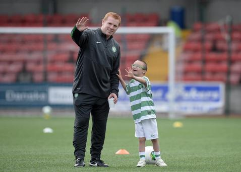 16/7/13. Pacemaker Press Belfast. Manager Neil Lennon at Solitude alongside nine year old Jay Betty from Lurgan, Lennon's home town for this evenings training session ahead of the Champions League qualifier between Clistonville and Celtic tomorrow evening. Picture Charles McQuillan/Pacemaker.