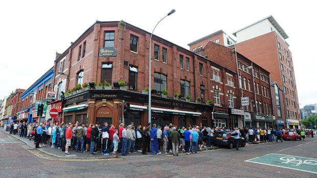 Pacemaker Press Belfast 15-07-2013: Cliftonville FC sell around 500 tickets at Sean Graham's on King Street Belfast on Tuesday morning for their eagerly-awaited Champions League match against Celtic at Solitude. The tickets have become available because Celtic returned some of their allocation for Wednesday's game. Picture By: Arthur Allison.