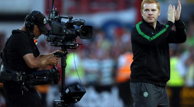Celtic manager Neil Lennon applauds the fans after defeating Cliftonville during the first leg of the UEFA Champions League Second Round Qualifying at Solitude, Belfast.